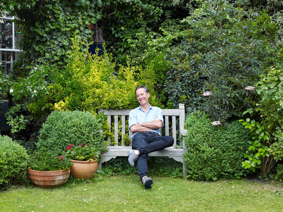 Richard E Grant, in his garden at home in Richmond.